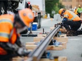 Crews work on sections of rail for the Hilltop Tacoma Link extension.