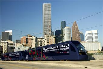 Siemens rail cars, like the one seen here promoting businesses along the new transit corridors, are in service on Houston's METRORail system and offer fast, reliable transport that will expand with the opening of the new Southeast/Purple Line and the East End/Green Line in 2015.