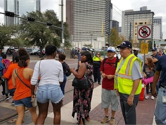 Lambert (shown on right) donned a safety vest to help direct people at the rail station during the Houston Astros parade celebrating the baseball team's World Series win. Photo: Metro