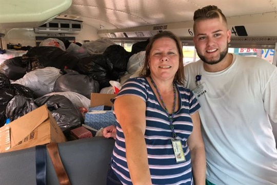 At Humble ISD near Houston, school bus drivers have been transporting storm evacuees and supplies. Seen here are drivers Tiffany Acton and Daniel Laughlin with a busload of donated food and supplies. Photo courtesy Humble ISD