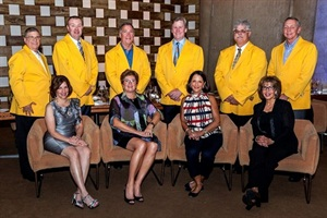 IC Bus presented its Pursuit of Excellence award to six North American dealerships. Pictured are the dealer winners in their yellow IC Bus coats.