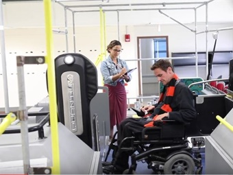 Brittany Perez (left) and Michael Rembis (right), an assistant professor of history at UB, test out wheelchair a securement system. Photo courtesy of the University of Buffalo.