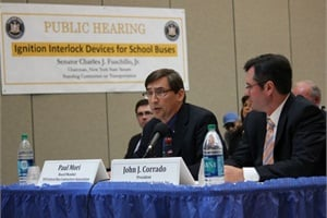 Paul Mori (left), an NYSBCA board member and school bus industry veteran, represented the association at a New York Senate hearing on Thursday on a bill that would mandate alcohol ignition interlock devices on school buses in the state. At right is John Corrado, president of Suffolk Transportation Services in Bay Shore, N.Y.