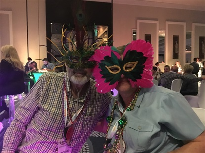 Richard and Connie Barnes from Barnes Tire & Service Centers Tire Pros show their Mardi Gras spirit at the Tire Pros dealer meeting in New Orleans.
