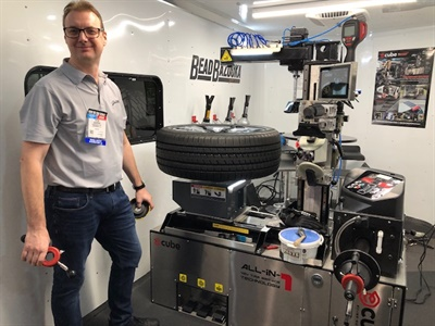 Gaither Tool set up the E-Cube mobile tire servicing unit in a van to demonstrate its small size and capabilities to SEMA Show attendees. Pete Scheepers, the inventor of the E-Cube, is pictured.
