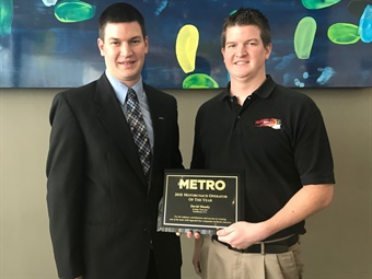 David Moody, left, and Jonathan Moody, right, of Holiday Tours, accepted METRO Magazine's Motorcoach Operator of the Year award in San Antonio Sunday.