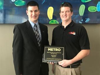 David Moody, left, and Jonathan Moody, right, of Holiday Tours, acceptedMETRO Magazine's Motorcoach Operator of the Year award in San Antonio Sunday.