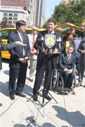 William Scalzi, president of Accessible Dispatch, the Connecticut company that will dispatch wheelchair accessible taxis in NYC (center); David Yassky, Chairman of the NYC Taxi and Limousine Commission (left); and Victor Calise, Commissioner of the Mayor's Office for People with Disabilities (right).