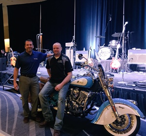 Matt Leeper from Falken Tire, left, presented a grand prize motorcycle toRon Barlow from FTC Enterprises during the final dinner of the K&M Tire 2018 Dealer Conference.