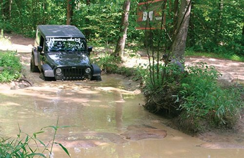 Traversing a thick mud pit is no problem with Grabber X3s. Dunk them in gunk and they keep on going.