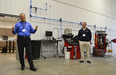 John Tak, director of marketing and product development (left, with engineer Steve Ludwig), talks about IMI's new headquarters, complete with an engineering lab.
