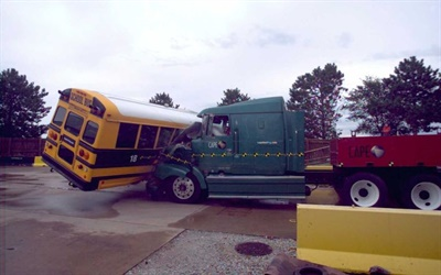 IMMI demonstrated its new lap-shoulder-belted seat with a high-impact crash test: a semi-truck hitting the side of a school bus.