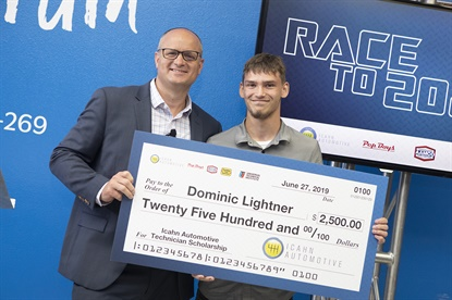 Brian Kaner of Icahn Automotive, left, presented Dominic Lightner, an automotive technology student at UTI in Orlando, with a $2,500 scholarship.