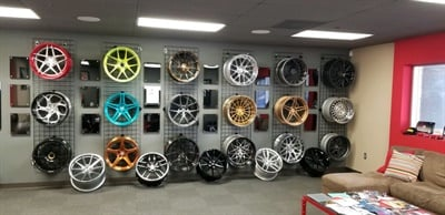 Ice Performance Tires & Wheels keeps a wall of wheels on display in its showroom. But Targaczewski doesn't maintain an inventory because he wants to help customers find the right wheel.