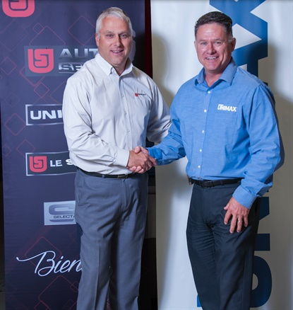 Mario Comtois, national business solutions manager for Uni-Select, and Alan Morris, strategic account manager for Unimax, celebrate the partnership of the two Canadian companies.