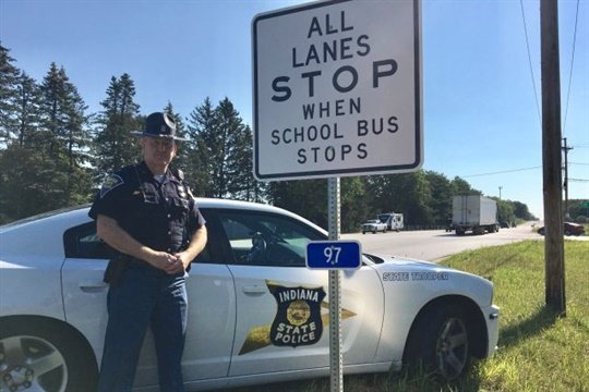 Indiana Trooper Jim Zeser has successfully lobbied for signs that alert drivers to stop for school buses. Photo courtesy Indiana State Police
