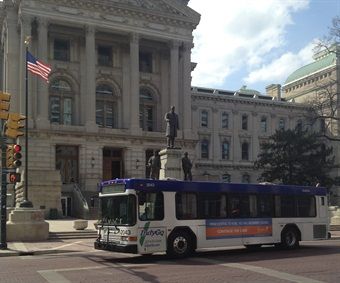 An IndyGo bus travels downtown.