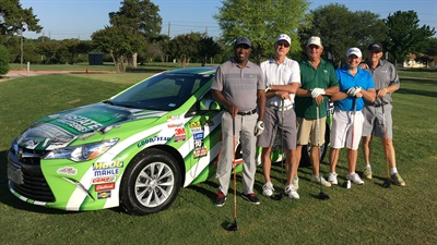 A golf team made up of active, reserve and retired military pause for a photo during their day pro-am day of golf sponsored by Interstate Batteries.