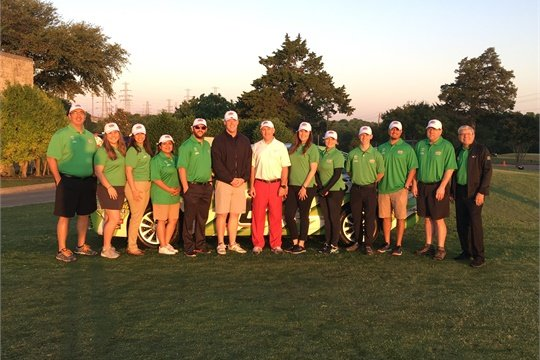 Interstate Batteries employees who volunteered at the pro am event.