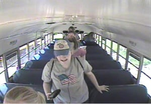 Investigators released this school bus video surveillance image of Kathlynn Shepard exiting her bus shortly before she was abducted. The 15-year-old was wearing jeans, a gray T-shirt and a Cubs ball cap.