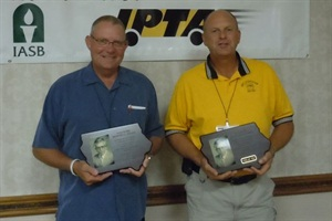 Owen Freese (left) and Verlan Vos, who have both been inspecting Iowa's school buses for 13 years, received the prestigious Tom Horn Memorial Award.