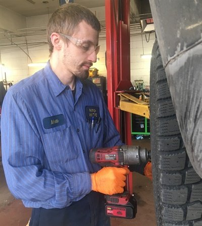 """I'm the only person at the sales counter, and I have two full-time guys in the bac,"" says Mike Spitale, general manager at Parrish-McIntyre Tire Co.'s Akron, Ohio, store. (Pictured, Parrish-McIntyre Technician Matt Clapper.)"