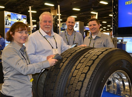 Goodyear's Michele Root (far left) and Johnny McIntosh (far right) show Goodyear's new Tire Optix software to Jeff Lecklider and John Welshfrom Gem City Tire in Dayton, Ohio. Goodyear gave dealers at its 2018 customer conference in January a preview of the new tire inspection software.