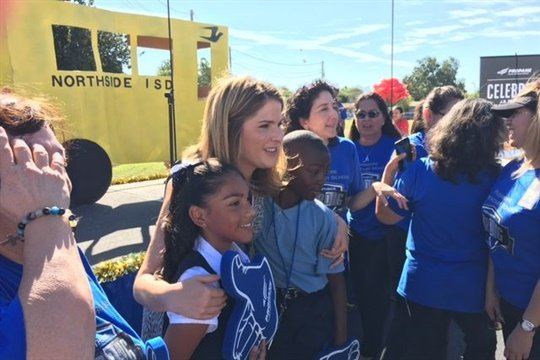 Jenna Bush Hager poses with students at a propane school bus event at Northside ISD in Texas.