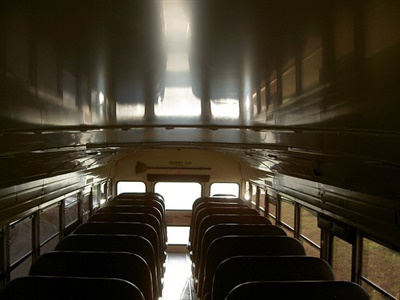 An Oklahoma driver resigned and an aide was suspended after reportedly leaving a 7-year-old with a wheelchair on a bus for over six hours and not reporting it. File photo courtesy John Horton