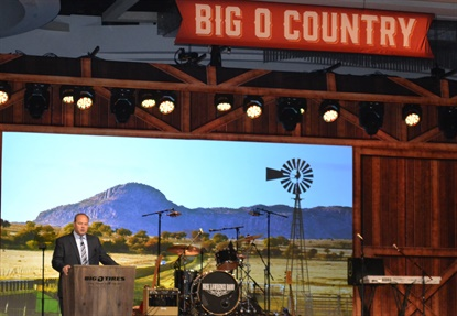John Kairys addresses the crowd of Big O Tires owners and managers during the franchise's annual meeting in San Antonio.