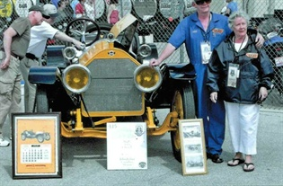 In May, John and Janice drove this 1914 Stutz Bearcat around the  Indianapolis Motor Speedway track. John's father drove the same car  around the oval in 1952.