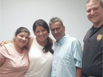 Jose Lopez reunited with his daughters (shown with Officer Sean Pfeifer) after more than 24 years. NJ Transit