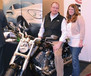 Nate and Jennifer Benham of Sparta Tire & Automotive in Sparta, Mich., won the 2014 Harley Davidson from Hankook Tire America Corp. at the K&M dealer meeting.