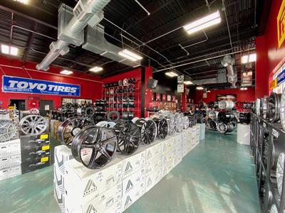 The 10,000-square-foot showroom at KC Trends Motorsports features a large selection of aftermarket wheel brands. Owner Chad Dearth says most customers come in for wheel and tire packages. The building has six bays, with each bay holding up to three vehicles.