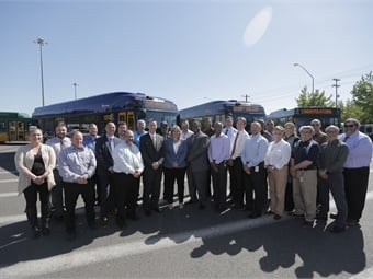 Representatives from New Flyer and King County Metro mark the milestone Xcelsior bus. King County Metro