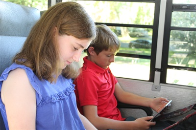 Connectivity solution supplier Kajeet awarded Austin (Texas) Independent School District a grant valued at over $600,000 to install 534 of its Wi-Fi routers on its school bus fleet. Photo courtesy Kajeet