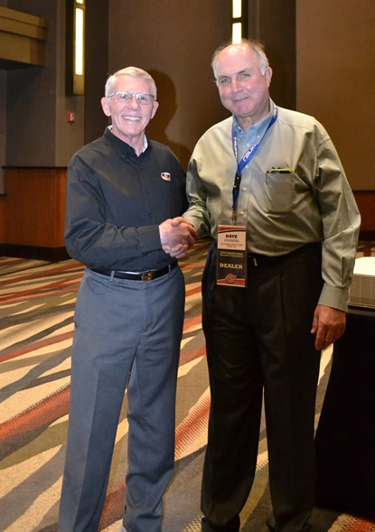 Ken Lanhals, left, CEO of K&M Tire, congratulates Dave Sylvester of Sylvester Truck & Tire Service, the Mr Tire/Big 3 Tire Commercial Tire Dealer of the Year.