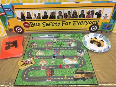 The school bus safety curriculum the students designed includes a board game and a recipe for a school bus-themed treat.