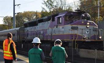Left to Right: Coutu, Fedal, and Brackett look on as a Worcester-bound train pulls into Westborough Station. Photo: Keolis Commuter Services