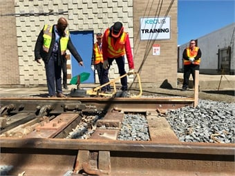 (Top to bottom) Keolis trainees learning how to use track switches. A simulation lab at the Cobble Hill railroad operations facility provides an immersive rail operation experience.