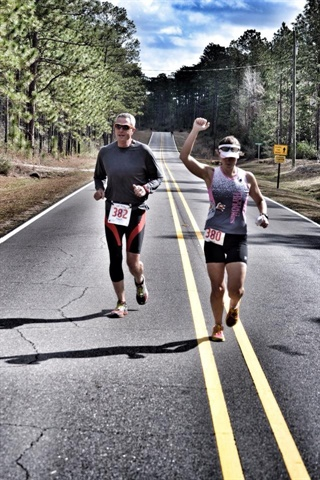 Kevin Coggin running a triathalon with his daughter last year. (Photo used with permission by Kevin Coggin.)