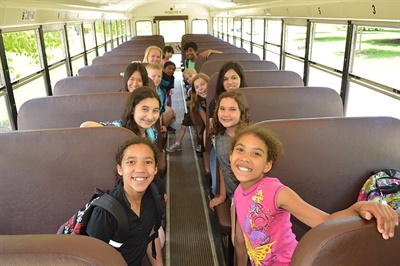 Onboard Wi-Fi, such as the SmartBus solution provided by Kajeet, gives all students the chance to complete their homework during the ride. It also can reportedly be considered an instructional expense, and the router can accommodate other technologies, such as GPS. Photo courtesy School Bus Safety Co.