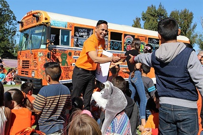 Dr. Syed Hyder, the district's director of elementary curriculum,  handed out kindness stickers to students on Oct. 19, named Unity Day as part of National Bullying Prevention Month.