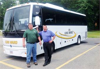 Dennis King (left), president of King Ward Coach Lines, and (right) Tony Mongiovi, VP, sales & service Northeast at CH Bus Sales in front of TS30.