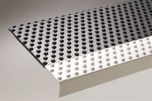 Koroseal's Pebble Tread has a non-directional raised pattern that provides an aggressive traction surface and still allows for ease of sweeping.