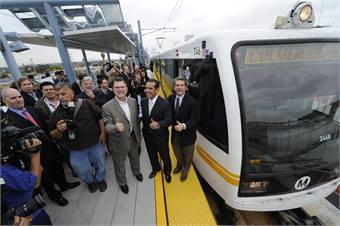 Los Angeles Mayor and Metro Board Chair Antonio Villaraigosa (second from right) announced the opening day for Metro's Expo light rail line during a test train ride held Friday. Photo credit Metro/Gary Leonard.