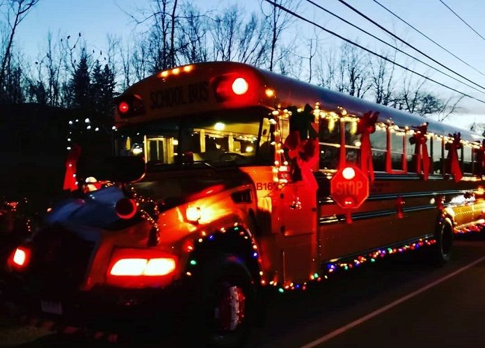Shown here is the bus lit up and headed to the parade. Photo courtesy Paul Dupuis