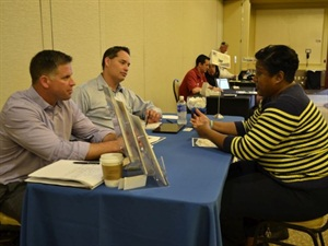 At SBX, school bus operators were given scheduled times to meet with suppliers. Here, Wanda Paul of Dallas Independent School District talks with Zonar's Craig Kahoun (left) and Toby McGraw.