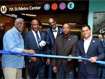 Rapper and entertainer Snoop Dogg (center) joined Metro CEO Phillip A. Washington in cutting the ribbon for the new A Line during an event.