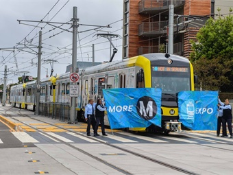 To kick off the grand opening, an Expo Line train carrying local, state and federal elected officials and executives from the Metro Exposition Construction Authority broke through a giant banner at Colorado Avenue and 5th Street near the Downtown Santa Monica Station. Photo: LA Metro